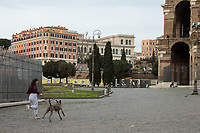 """Taking pets out: allowed with restrictions.<br /> <br /> Rome, 12/03/2020. Documenting Rome under the Italian Government lockdown for the Outbreak of the Coronavirus (SARS-CoV-2 - COVID-19) in Italy. On the evening of the 11 March 2020, the Italian Prime Minister, Giuseppe Conte, signed the March 11th Decree Law """"Step 4 Consolidation of 1 single Protection Zone for the entire national territory"""" (1.). The further urgent measures were taken """"in order to counter and contain the spread of the COVID-19 virus"""" on the same day when the WHO (World Health Organization, OMS in Italian) declared the coronavirus COVID-19 as a pandemic (2.).<br /> ISTAT (Italian Institute of Statistics) estimates that in Italy there are 50,724 homeless people. In Rome, around 20,000 people in fragile condition have asked for support. Moreover, there are 40,000 people who live in a state of housing emergency in Rome's municipality.<br /> March 11th Decree Law (1.): «[…] Retail commercial activities are suspended, with the exception of the food and basic necessities activities […] Newsagents, tobacconists, pharmacies and parapharmacies remain open. In any case, the interpersonal safety distance of one meter must be guaranteed. The activities of catering services (including bars, pubs, restaurants, ice cream shops, patisseries) are suspended […] Banking, financial and insurance services as well as the agricultural, livestock and agri-food processing sector, including the supply chains that supply goods and services, are guaranteed, […] The President of the Region can arrange the programming of the service provided by local public transport companies […]».<br /> Updates: on the 12.03.20 (6:00PM) in Italy there 14.955 positive cases; 1,439 patients have recovered; 1,266 died.<br /> <br /> Footnotes & Links:<br /> Info about COVID-19 in Italy: http://bit.do/fzRVu (ITA) - http://bit.do/fzRV5 (ENG)<br /> 1. March 11th Decree Law http://bit.do/fzREX (ITA) - http://bit.do/fzRFz (ENG)<br /> 2. http://bit."""