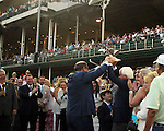 June 13, 2015 Ahmed Zayat of Zayat Stables and trainer Bob Baffert hold the Triple Crown winner's trophy for American Pharoah, who won the 2015 running of the first jewel of the Triple Crown at Churchill Downs.  ©Mary M. Meek/ESW/CSM