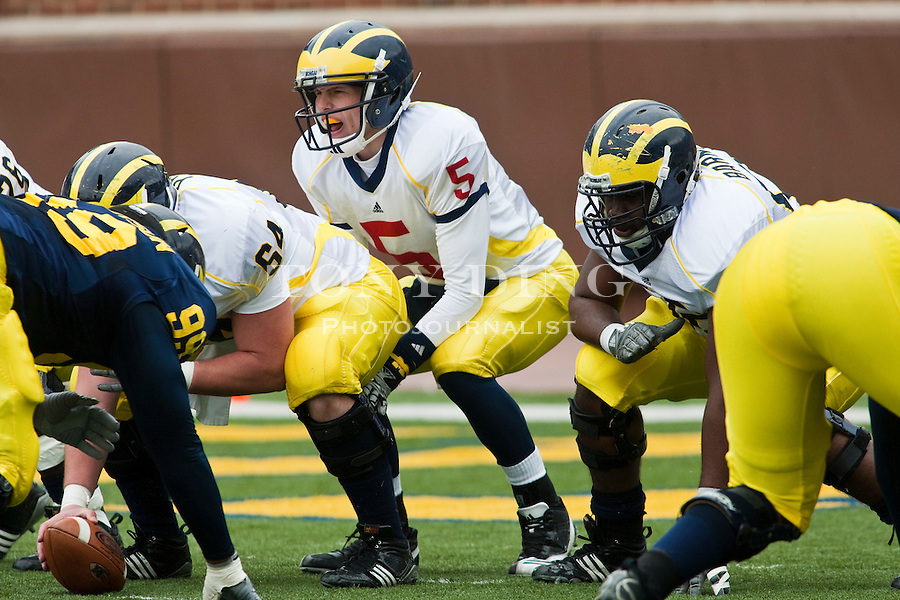 Michigan quarterback Tate Forcier (5) calls out a snap at the line of scrimmage during the Wolverines' spring football game, Saturday, April 17, 2010, in Ann Arbor, Mich. (AP Photo/Tony Ding)