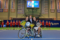December 20, 2014, Rotterdam, Topsport Centrum, Lotto NK Tennis, Mens doubles wheelchair final,  winners Maikel Scheffers (L) with his partner Rick Molier,in the middle KNLTB director Erik Poel<br /> Photo: Tennisimages/Henk Koster