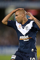 MELBOURNE, AUSTRALIA - NOVEMBER 06: Archie Thompson of the Victory reacts after missing a goal during the round 13 A-League match between the Melbourne Victory and Gold Coast United at Etihad Stadium on November 6, 2010 in Melbourne, Australia (Photo by Sydney Low / Asterisk Images)