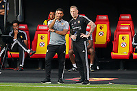 Watford caretaker manager Hayden Mullins and Watford head of goalkeeping Graham Stack during the Premier League match between Watford and Manchester City at Vicarage Road, Watford, England on 21 July 2020. Football Stadiums around remain empty due to the Covid-19 Pandemic as Government social distancing laws prohibit supporters inside venues resulting in all fixtures being played behind closed doors until further notice.<br /> Photo by Andy Rowland.