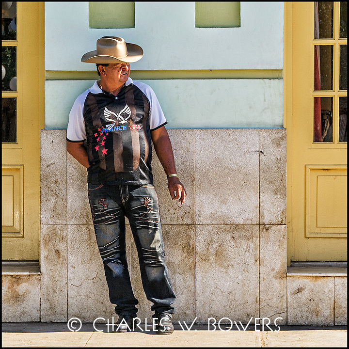 Faces Of Cuba - guys hang out on the street. Is he from Texas?<br />