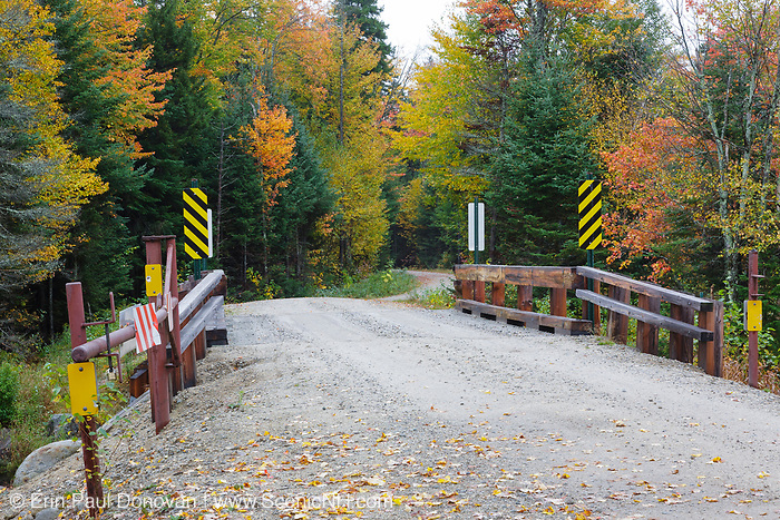 Elbow Pond Road at the Jackman Brook crossing in North Woodstock, New Hampshire during the autumn months. This is a seasonal road that is closed during the winter months. And it follows the old railroad bed of the Elbow Pond Branch of the Gordon Pond Railroad (1907-1916).