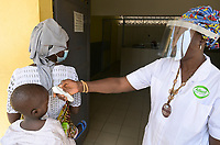 "SENEGAL, Casamance, Ziguinchor, Caritas health station, fever measuring during Corona pandemic /Gesundheitsstation ""Saint Joseph"" der Caritas in LYNDIANE, Fiebermessung in Corona Zeiten"