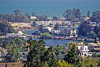 Carthage, Tunisia.  Punic Ports, now resembling small lakes bordered by luxurious homes, date from the 4th. Century B.C.  The foreground was the naval, or military, port.  The  commercial port is adjacent, farther back.  Bay of Tunis in the background.