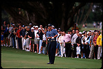Tiger Woods chips from the fairway at the Genuity Open at Doral in Miami, Fl.