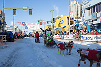 Laura Neese and team leave the ceremonial start line with an Iditarider and handler at 4th Avenue and D street in downtown Anchorage, Alaska on Saturday March 4th during the 2017 Iditarod race. Photo © 2017 by Brendan Smith/SchultzPhoto.com.