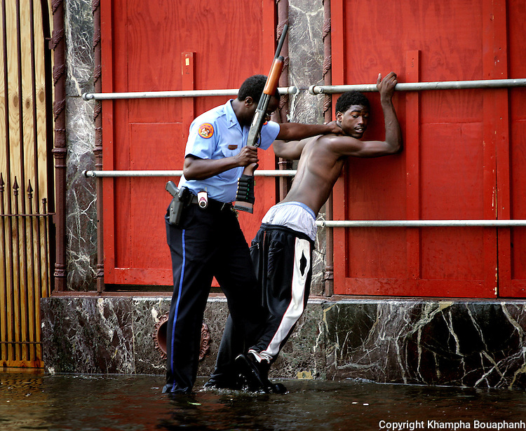 New Orleans police flush out looters on Canal Street a on Tuesday, August 30, 2005.  Hurricane Katrina devasted the city and surrounding areas.  (Photo by Khampha Bouaphanh)