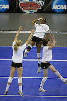Omaha, NE - DECEMBER 20:  Middle blocker Foluke Akinradewo #16 of the Stanford Cardinal during Stanford's 2008 NCAA Division I Women's Volleyball Final Four Championship closed practice before playing the Penn State Nittany Lions on December 20, 2008 at the Qwest Center in Omaha, Nebraska.