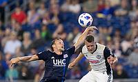 Foxborough, Massachusetts - August 11, 2018: In a Major League Soccer (MLS) match, Philadelphia Union (white) defeated New England Revolution (blue/white), 3-2, at Gillette Stadium.<br /> Penalty kick handball.