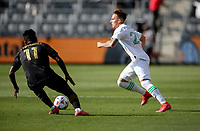 LOS ANGELES, CA - APRIL 17: Žan Kolmanič #21 of Austin FC chases a loose ball during a game between Austin FC and Los Angeles FC at Banc of California Stadium on April 17, 2021 in Los Angeles, California.