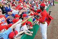 Philadelphia Phillies outfielder Domonic Brown #9 signs autographs before a Spring Training game against the Boston Red Sox at Bright House Field on March 24, 2013 in Clearwater, Florida.  Boston defeated Philadelphia 7-6.  (Mike Janes/Four Seam Images)