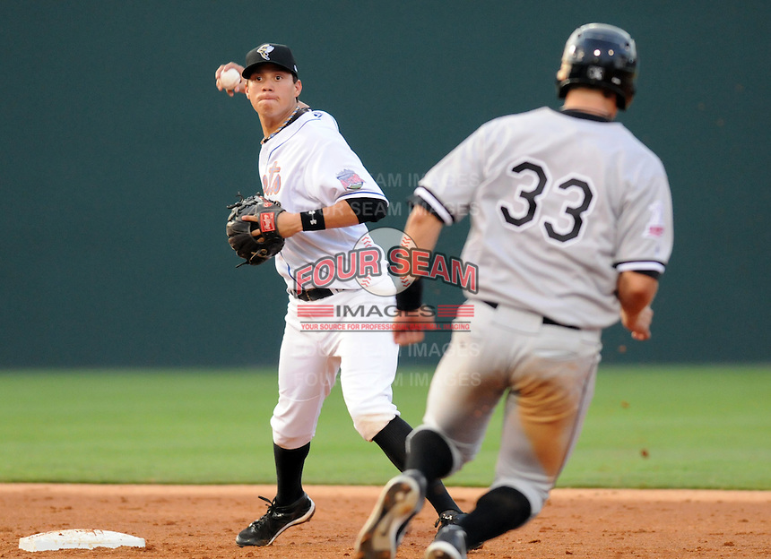 Wilmer Flores of the Savannah Sand Gnats makes the first part of a double play, putting out Ian Gac of the Kannapolis Intimidators at the 2010 South Atlantic League All-Star Game on Tuesday, June 22, 2010, at Fluor Field at the West End in Greenville, S.C. Photo by: Tom Priddy/Four Seam Images