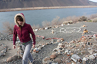 Shae Moore  (CQ) walks back towards her house away from her meditation circle where she likes to  be exposed to nature in Schawana, Wash. along the Columbia River on February 8, 2011.