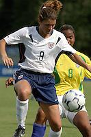 Mia Hamm v Renata of Brazil. 7/13/03. Tad Gormley Stadium New Orleans...Photo by J. Brett Whitesell/ISI