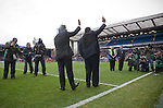 Blackburn Rovers 2 Aston Villa 0, 21/11/2010. Ewood Park, Premier League. New Blackburn Rovers owners Balaji and Venkatesh Rao (left) waving to the crowd at Ewood Park before the club played host to Aston Villa in a Barclays Premier League match. Blackburn won the match by two goals to nil watched by a crowd of 21,848. It was Rovers' first match under the ownership of Indian company Venky's. Photo by Colin McPherson.