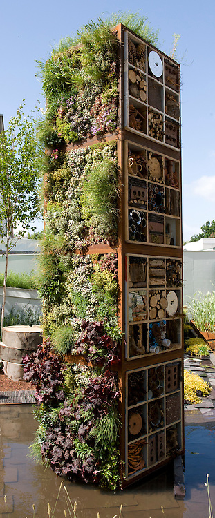 """Tower containing living wall and bug boxes or insect hotels. """"Future Nature"""" Garden, by Ark Design Management Ltd, RHS Chelsea Flower Show 2009."""