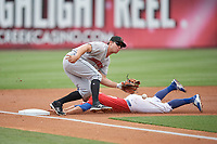 Indianapolis Indians third baseman Eric Wood (14) fields a throw as Jon Berti (8) slides in safely on a stolen base during a game against the Buffalo Bisons on August 17, 2017 at Coca-Cola Field in Buffalo, New York.  Buffalo defeated Indianapolis 4-1.  (Mike Janes/Four Seam Images)
