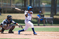 AZL Dodgers center fielder Aldrich De Jongh (51) follows through on his swing in front of catcher Luis Roman (4) during an Arizona League game against the AZL Padres 2 at Camelback Ranch on July 4, 2018 in Glendale, Arizona. The AZL Dodgers defeated the AZL Padres 2 9-8. (Zachary Lucy/Four Seam Images)