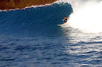 Tow-in surfer (MR) is just at the beginning of a ride on one of Maui's winter swells. Hawaii