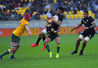 NZ's Ardie Savea is tackled during the Bledisloe Cup rugby union match between the New Zealand All Blacks and Australia Wallabies at Sky Stadium in Wellington, New Zealand on Sunday, 11 October 2020. Photo: Dave Lintott / lintottphoto.co.nz