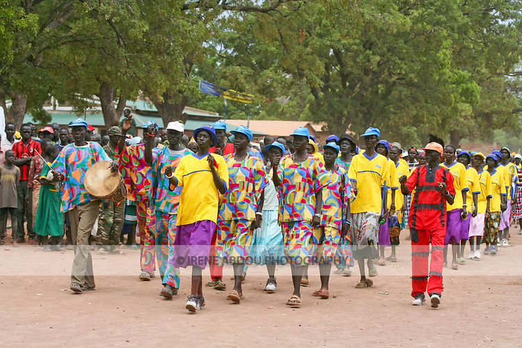 Organized by the international NGO, Population Services International (PSI), men and women from two Dinka folklore groups march into Rumbek's Freedom Square to raise awareness about malaria prevention on Africa Malaria Day.