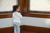 MR / Schenectady, NY. Pensive pre-school aged child (girl, 3, African American and Caucasian) looks out the window. MR: Dal5. ID: AM-HD. © Ellen B. Senisi