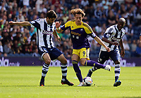 Sunday 01 September 2013<br /> Pictured: Michu of Swansea (C) against Claudio Yacob (L) and Youssouf Mulumbu (R) of West Brom. <br /> Re: Barclay's Premier League, West Bromwich Albion v Swansea City FC at The Hawthorns, Birmingham, UK.