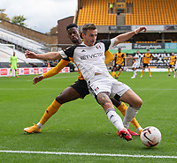 Fulham's Joe Bryan (right) is tackled from behind by Wolverhampton Wanderers' Nelson Semedo (left)  <br /> <br /> Photographer David Horton/CameraSport<br /> <br /> The Premier League - Wolverhampton Wanderers v Fulham - Sunday 4th October 2020 - Molineux Stadium - Wolverhampton<br /> <br /> World Copyright © 2020 CameraSport. All rights reserved. 43 Linden Ave. Countesthorpe. Leicester. England. LE8 5PG - Tel: +44 (0) 116 277 4147 - admin@camerasport.com - www.camerasport.com