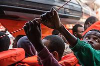 Sea Watch-2.<br /> Die Sea Watch-2 bei ihrer 13. SAR-Mission vor der libyschen Kueste.<br /> Die Sea Watch-2 hat am 22. Oktober 2016 knapp 200 Menschen an Bord aufgenommen. Sie mussten bis zum naechsten Tag auf dem Deck ausharren, bis ein Frontex-Schiff der spanischen Marine kam um sie nach Italien zu bringen.<br /> Im Bild: Die Gefluechteten warten um auf das Frontex-Schiff gebracht zu werden.<br /> 23.10.2016, Mediterranean Sea<br /> Copyright: Christian-Ditsch.de<br /> [Inhaltsveraendernde Manipulation des Fotos nur nach ausdruecklicher Genehmigung des Fotografen. Vereinbarungen ueber Abtretung von Persoenlichkeitsrechten/Model Release der abgebildeten Person/Personen liegen nicht vor. NO MODEL RELEASE! Nur fuer Redaktionelle Zwecke. Don't publish without copyright Christian-Ditsch.de, Veroeffentlichung nur mit Fotografennennung, sowie gegen Honorar, MwSt. und Beleg. Konto: I N G - D i B a, IBAN DE58500105175400192269, BIC INGDDEFFXXX, Kontakt: post@christian-ditsch.de<br /> Bei der Bearbeitung der Dateiinformationen darf die Urheberkennzeichnung in den EXIF- und  IPTC-Daten nicht entfernt werden, diese sind in digitalen Medien nach §95c UrhG rechtlich geschuetzt. Der Urhebervermerk wird gemaess §13 UrhG verlangt.]