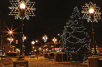 A nighttime view of Oakville's Town Square at Christmas time.