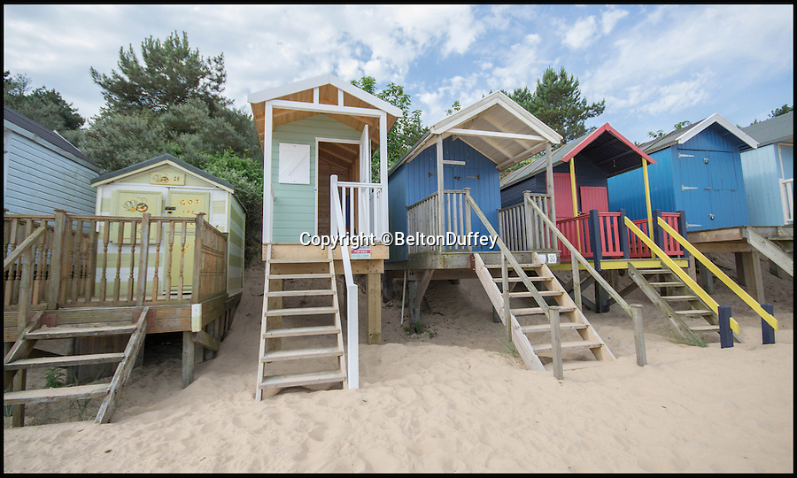 BNPS.co.uk (01202 558833)<br /> Pic: BeltonDuffey/BNPS<br /> <br /> A tiny empty beach hut on one of Britain's best beaches has gone on the market for £60,000 - a whopping £2,500 per square foot.<br /> <br /> The colourful 6ft by 4ft wooden hut has no services, a five-minute walk to the nearest toilet and the new owners can only use it during the day, not for overnight stays.<br /> <br /> But while the price tag might seem steep for the shed-like property, its place on the beach at Wells-next-the-Sea, Norfolk, makes it a valuable investment.