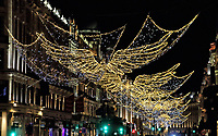 Regent Street famous Christmas lights now switched on for 2020. Very low key this year as it's usually a celebrity performing the switch on and mass crowds all along the road. London November 25th 2020<br /> <br /> Photo by Keith Mayhew