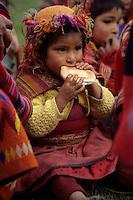 Willoq, Urubamba Valley, Peru - Quechua Girl Eating Bread