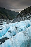 Looking towards Waiho valley from Defiance Icefall of Franz Josef Glacier when sun sets, Westland National Park, West Coast, World Heritage, South Island, New Zealand