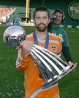 Houston captain Wade Barrett displays the Alan I. Rothenberg trophy after the match. The Houston Dynamo defeated the New England Revolution 2-1 in the finals of the MLS Cup at RFK Memorial Stadium in Washington, D. C., on November 18, 2007.