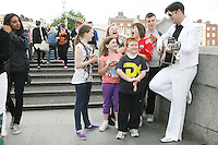 """NO REPRO FEE. 11/8/2010. Elvis Presley Story. Irelands foremost Elvis performer Kevin Doyle is pictured in his Elvis costume rehearsing on the Ha Penny Bridge Dublin with the Finnegan Family in preparation for his show """" Kevin Doyle Sings the Elvis Presley Story"""" this Sunday the 15th of August at the Olympia Theatre. Tickets are from 25.50 including booking fee on sale now. Picture James Horan/Collins Photos"""