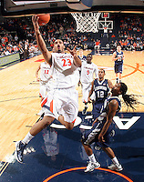 CHARLOTTESVILLE, VA- December 3: Mike Scott #23 of the Virginia Cavaliers shoots in front of Longwood Lancer defenders during the game on December 27, 2011 at the John Paul Jones Arena in Charlottesville, Virginia. Virginia defeated Longwood 86-53. (Photo by Andrew Shurtleff/Getty Images) *** Local Caption *** Mike Scott