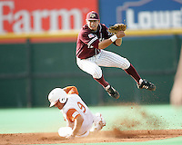 Texas A&M SS Jose Duran turns a double play in the 1st inning against Texas on May 16th, 2008 in Austin Texas. Photo by Andrew Woolley / Four Seam images..