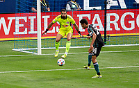 CARSON, CA - APRIL 25: Ethan Zubak #29 of the Los Angeles Galaxy moves towards Carlos Coronel #13 of the New York Red Bulls during a game between New York Red Bulls and Los Angeles Galaxy at Dignity Health Sports Park on April 25, 2021 in Carson, California.