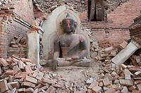 A Buddha statue stands in the rubbles at Bhaktapur, near Kathmandu, Nepal.  May 03, 2015