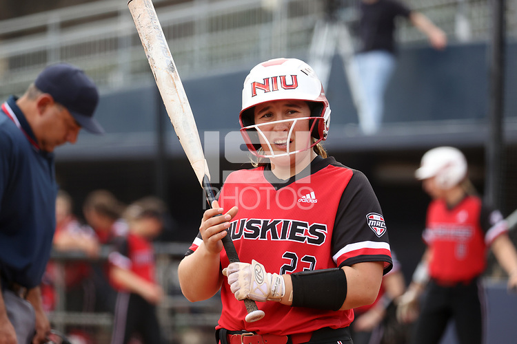 GREENSBORO, NC - MARCH 11: Anne Allen #23 of Northern Illinois University checks for signs before batting during a game between Northern Illinois and UNC Greensboro at UNCG Softball Stadium on March 11, 2020 in Greensboro, North Carolina.