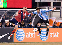 Jay DeMerit, Ezequiel Lavezzi. The USMNT tied Argentina, 1-1, at the New Meadowlands Stadium in East Rutherford, NJ.
