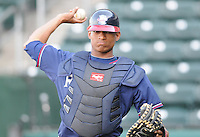 Catcher Christian Bethancourt (19) of the Rome Braves, Class A affiliate of the Atlanta Braves, prior to a game against the Greenville Drive April 12, 2010, at Fluor Field at the West End in Greenville, S.C. Bethancourt is the Braves'  No. 6 prospect, according to Baseball America. Photo by: Tom Priddy/Four Seam Images