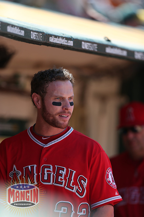 OAKLAND, CA - MAY 1:  Josh Hamilton #32 of the Los Angeles Angels watches from the dugout during the game against the Oakland Athletics at O.co Coliseum on May 1, 2013 in Oakland, California. Photo by Brad Mangin