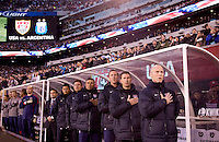 USMNT head coach Bob Bradley and the rest of the coaching staff sings the national anthem before an international friendly at New Meadowlands Stadium in East Rutherford, NJ.  The United States tied Argentina, 1-1.