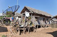 Myanmar, Burma.  Inle Lake Village and Satellite Dish, Shan State.