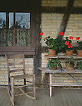 "Old World Wisconsin State Historic Site, Waukesha County, WI<br /> Geraniums and rocker on Koepsell House porch with a ""fachwerk"" style wall -(circa 1850)"