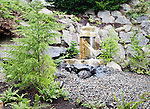 Water Feature in Entry Garden.  Private garden professionally landscaped.